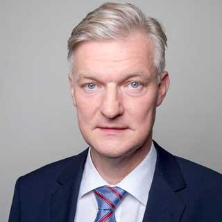 Portrait von BVMW-Chefvolkswirt Dr. Hans-Jürgen Völz