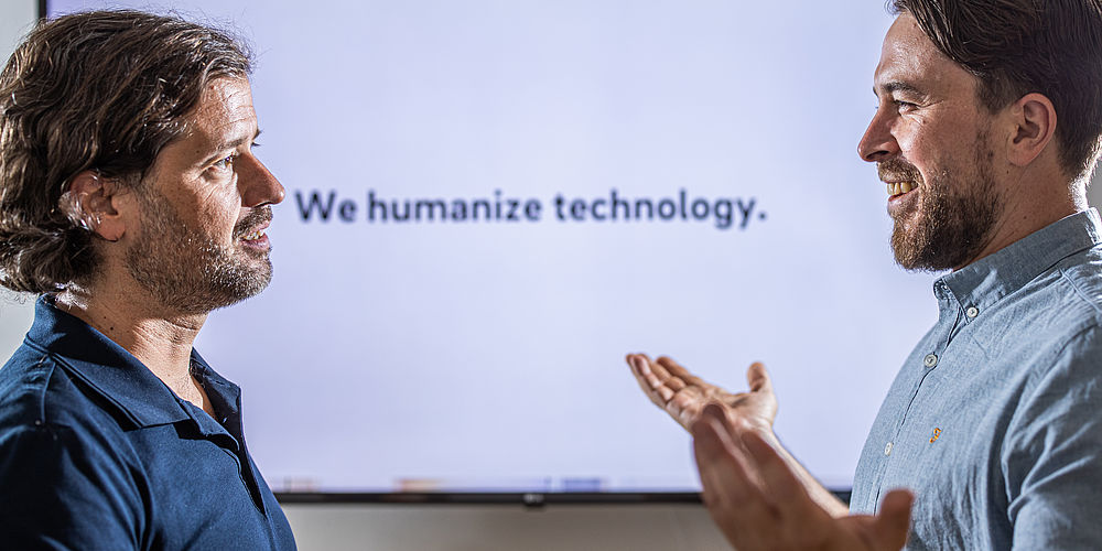 """We humanize technology."""